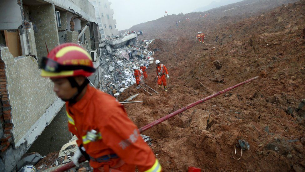 Firefighters search for survivors near a damaged building at the site of a landslide at an industrial park in Shenzhen, Guangzhou, China, December 20, 2015.