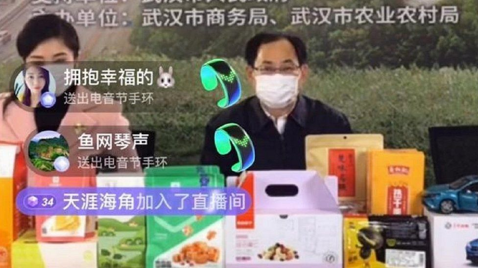 Li Qiang, Wuhan's incumbent deputy mayor, in a live-streaming saleroom.