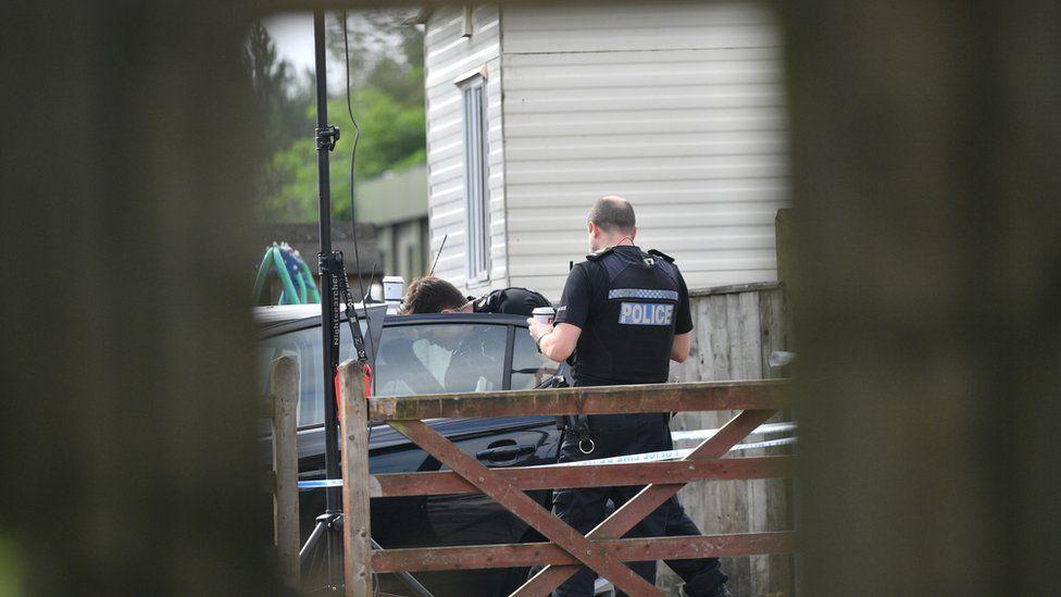 Police at caravan site near Burghfield Common