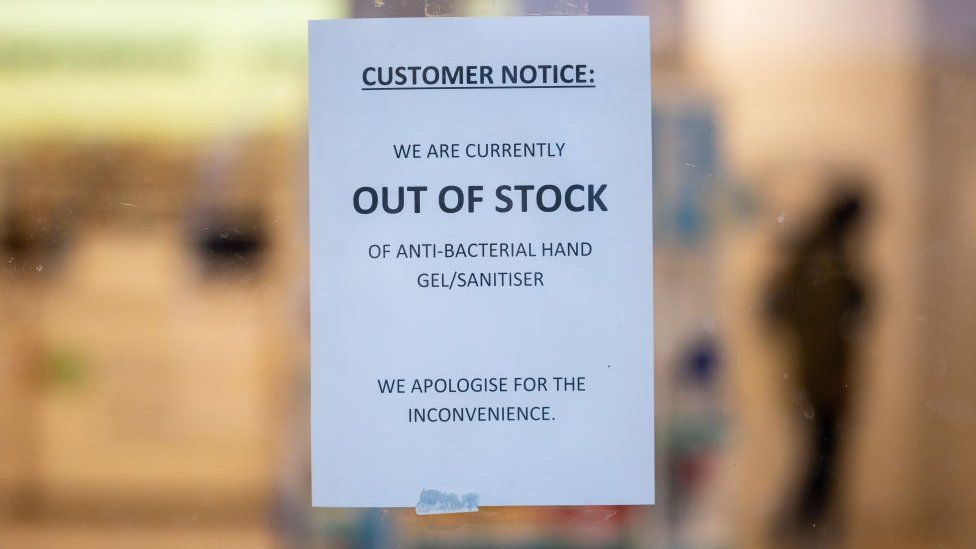 Sign says hand sanitiser is out of stock