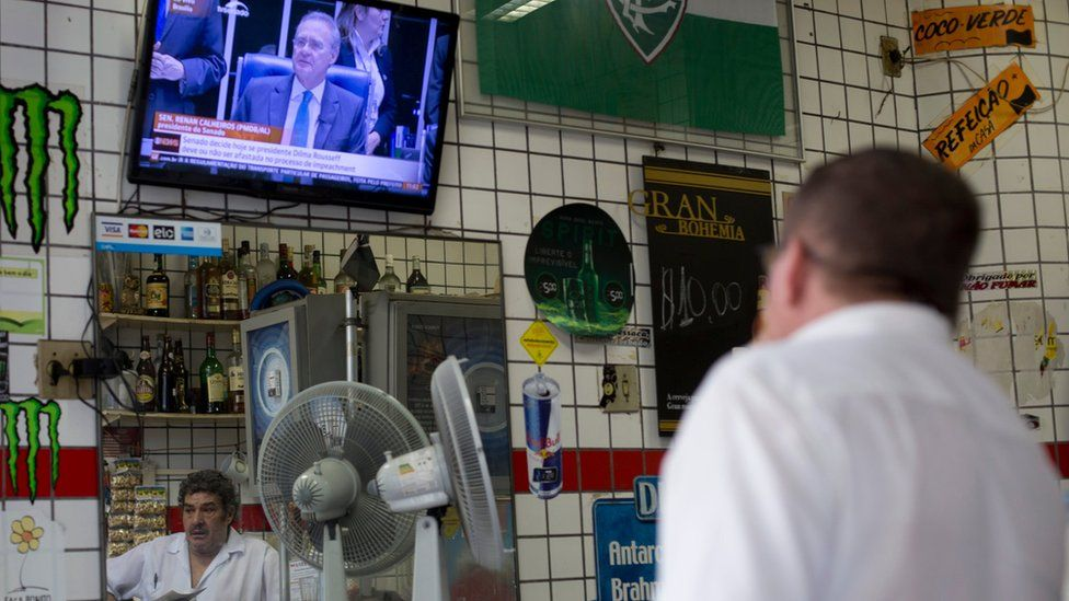 Man watches the Brazilian Senate session that is expected to culminate in a vote on whether to impeach President Dilma Rousseff, at a local bar in Rio de Janeiro on 11 May