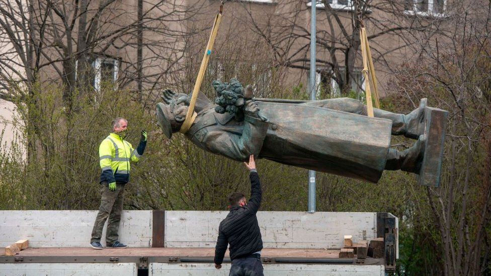 Workers remove a statue of Ivan Konev in Prague