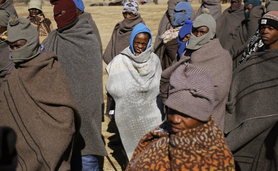 Basotho tribesmen wearing the traditional Basotho tribal blanket (Seanamarena) to stay warm in the bitterly cold mountain air in Semonkong, Lesotho, 15 July 2017 (issued 17 July 2017).