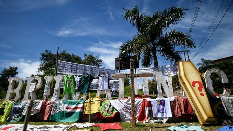 Tributes, posters and personal objects of victims of the dam collapse at a nearby iron-ore mine