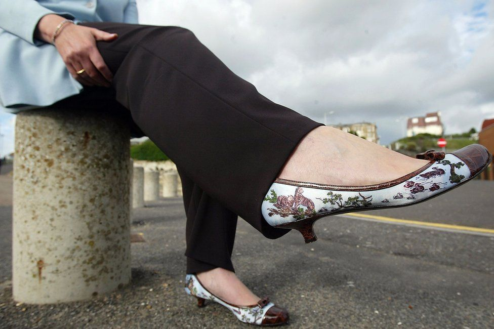Theresa May shows her shoes