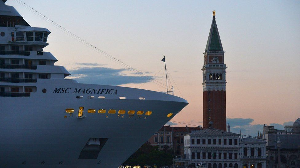 This file photograph taken on September 6, 2015 shows a cruise ship at sunset in Venice.
