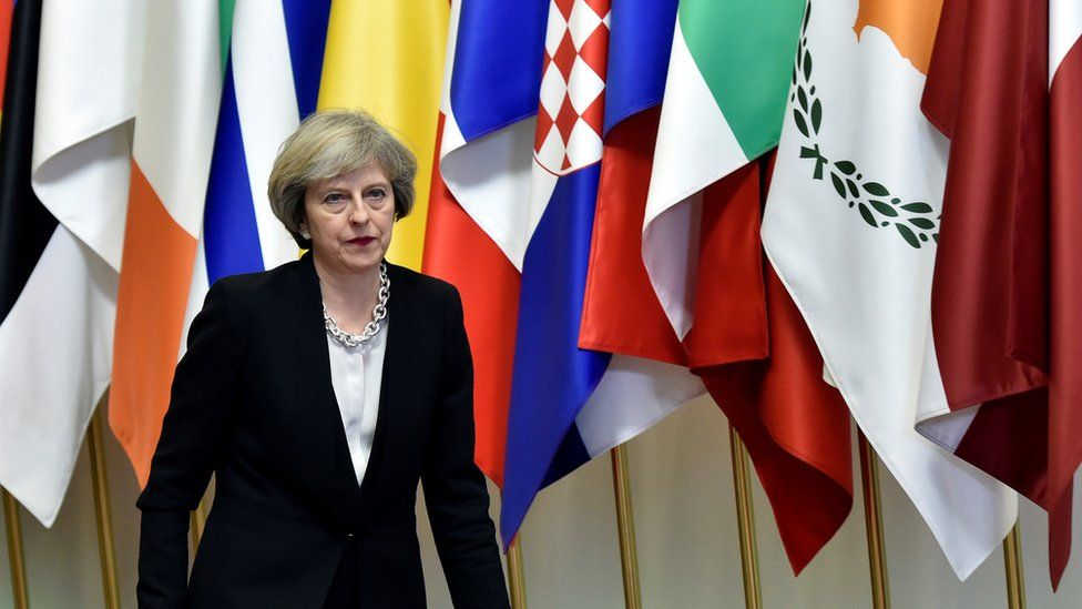 Theresa May/flags, Brussels, 15 Dec 16