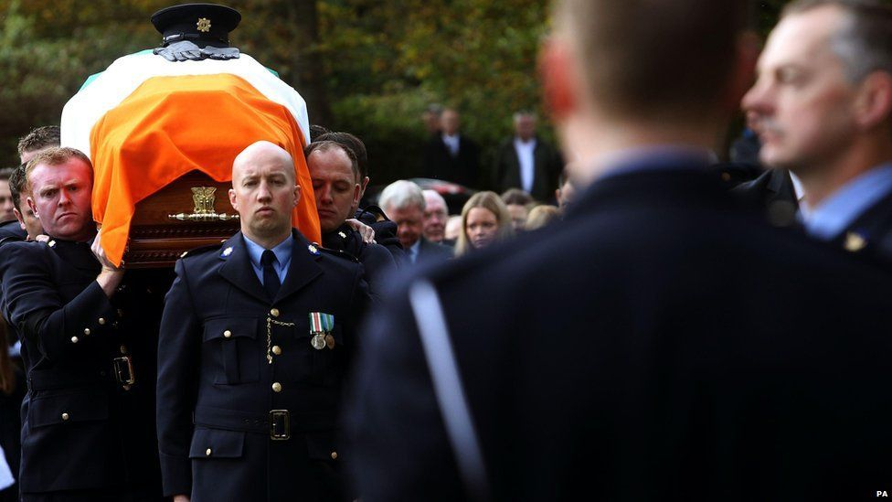 Uniformed officers formed a guard of honour as Anthony Golden's coffin was carried into the church