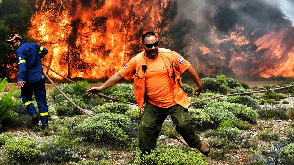Firefighters tackle a blaze in Greece