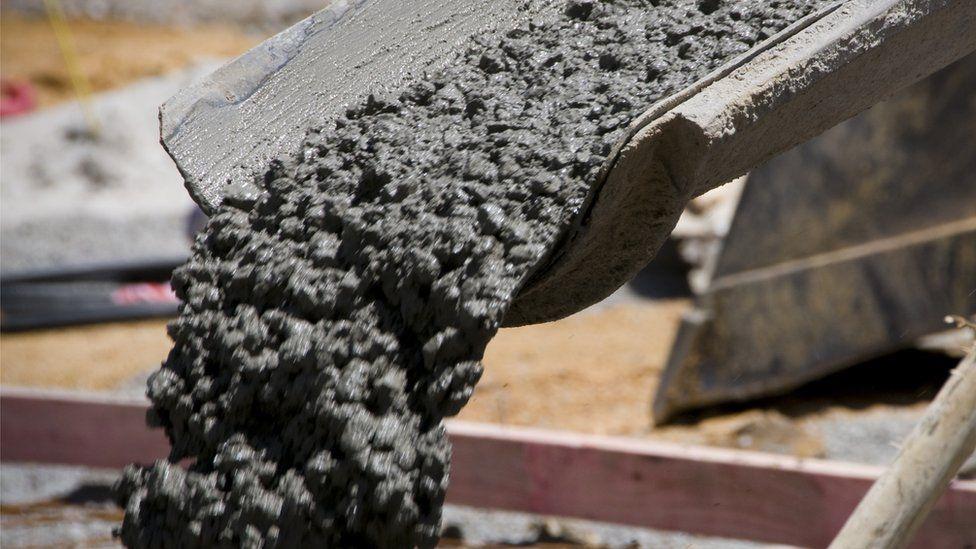 Concrete pours down a tube