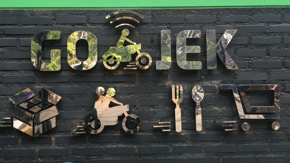Go Jek reception sign showing separate logos within the business.