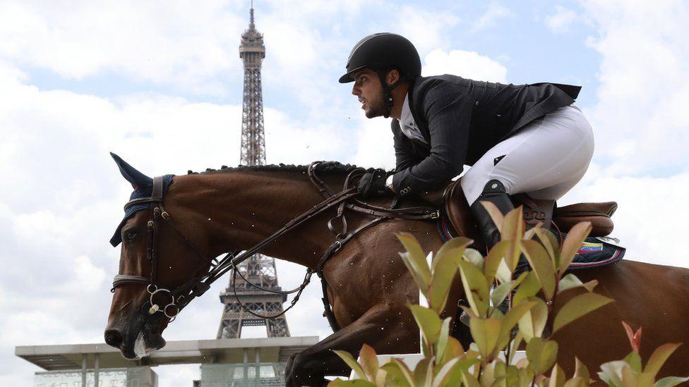Venezuela's Emanuel Andrade riding Reus de la Nutria competes during the Paris Eiffel Jumping event on July 2, 2017 in Paris.
