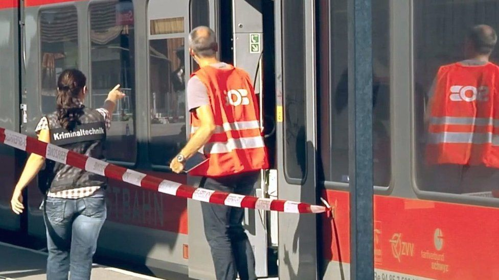 Forensic scientists at Salez station inspect the train involved in the 13 August attack