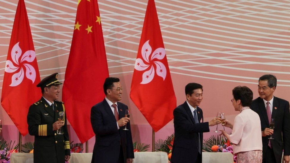 Luo Huining, pictured right of centre toasting with Hong Kong Chief Executive Carrie Lam