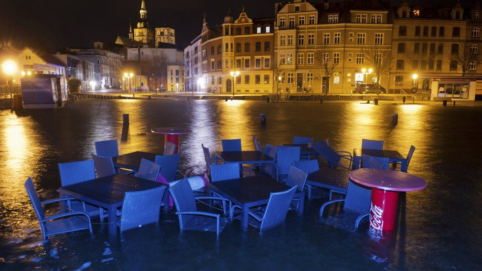Furniture of a restaurant is surrounded by flood water in the harbour at Stralsund, northern Germany (5 Jan)