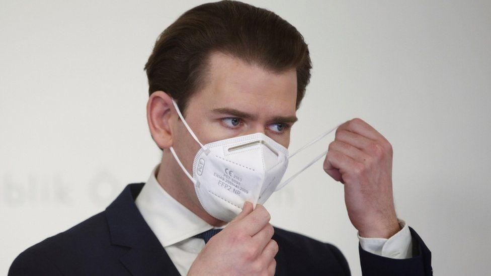 Austria's Chancellor Sebastian Kurz removes a face mask as he attends a news conference on 1 March