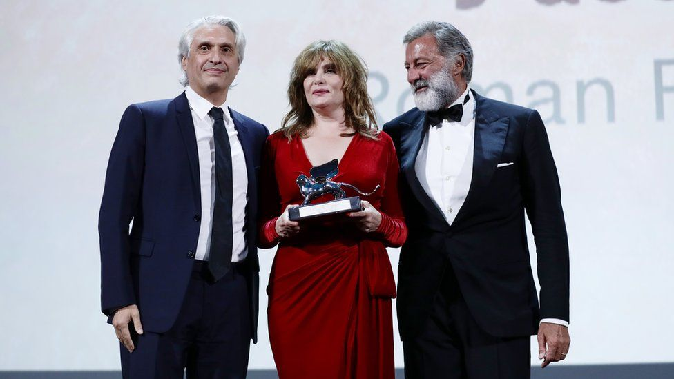 Producer Alain Goldman, actor Emmanuelle Seigner and co-producer Luca Barbareschi accepted the award for An Officer and a Spy at Venice Film Festival, 7 September 2019