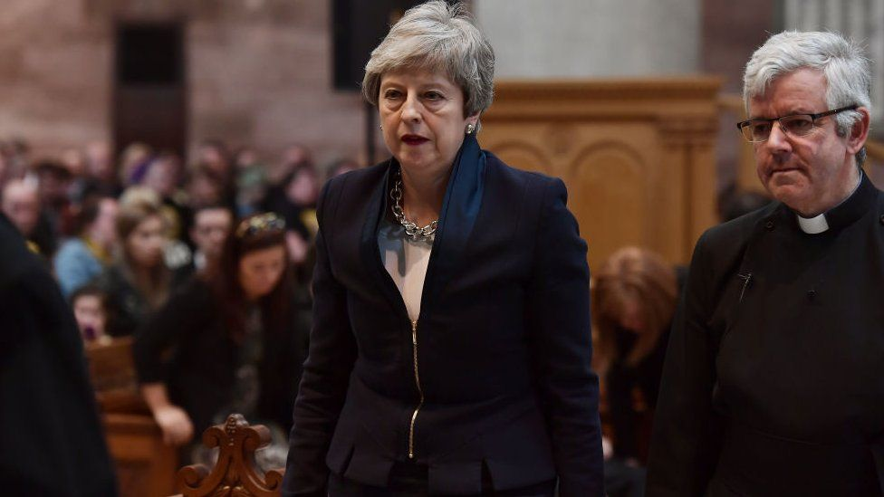 Prime Minister Theresa May arrives for the funeral service.