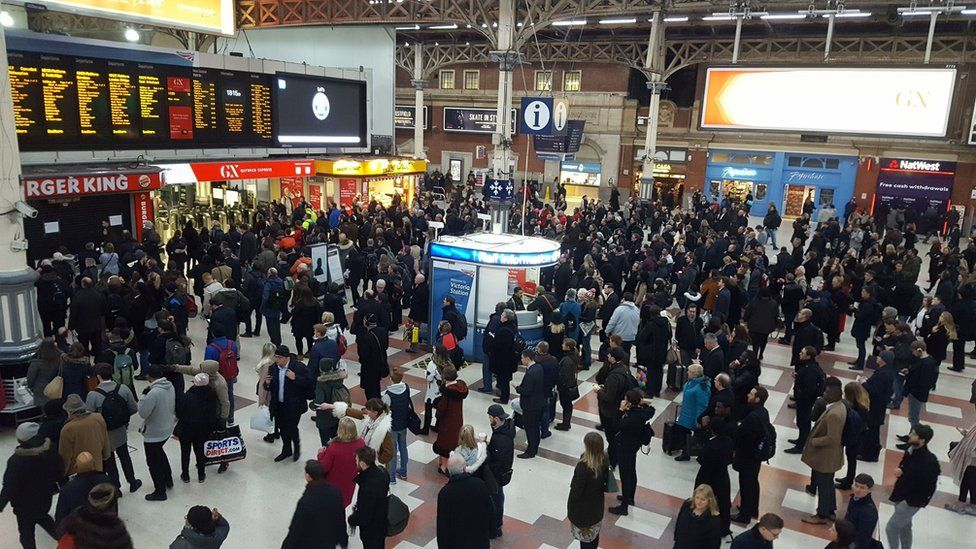 Commuters at London Victoria station