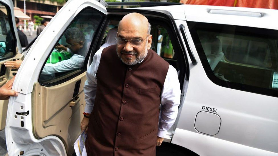Home Minister Amit Shah arrives at the parliament house in New Delhi on August 5, 2019.