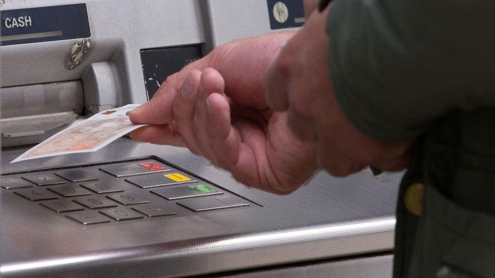 Man withdrawing cash from an ATM