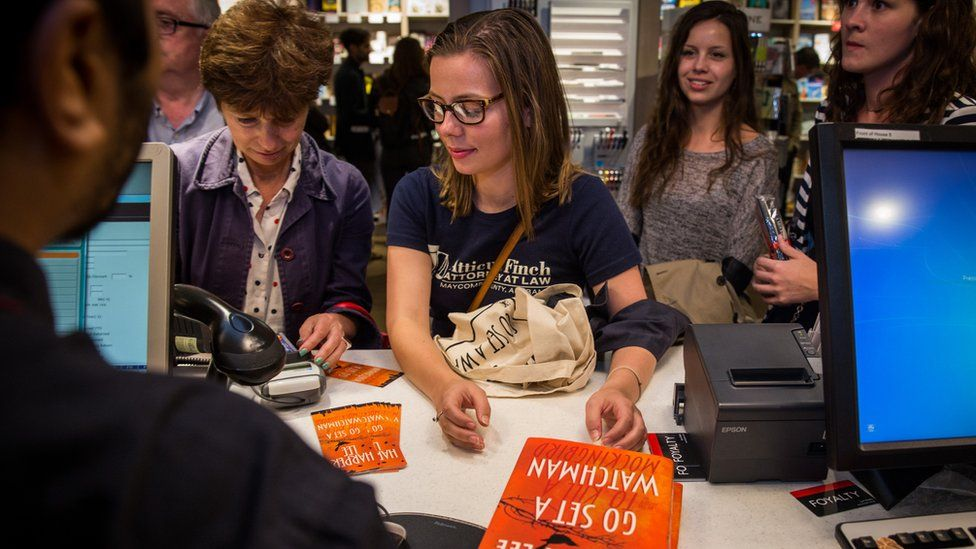 People buying 'Go Set A Watchman' by Harper Lee at Foyles book shop on July 14, 2015 in London