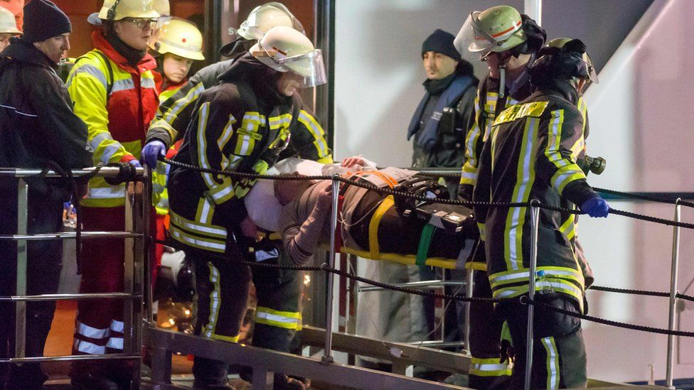 An injured passenger is evacuated on a stretcher during the rescue operation after the Swiss passenger ship Swiss Crystal hit a motorway bridge pylon on the Rhine River in the western city in Duisburg, Germany, 26 December 2017