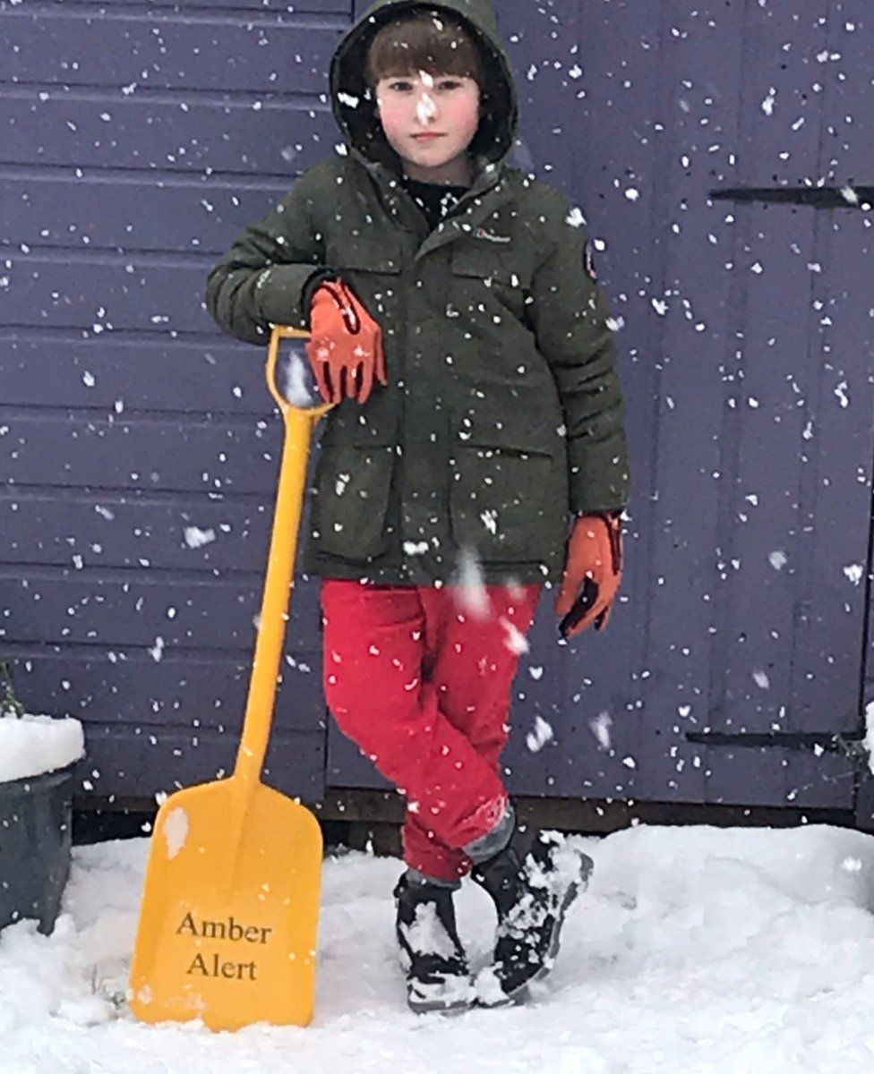Boy with shovel in snow