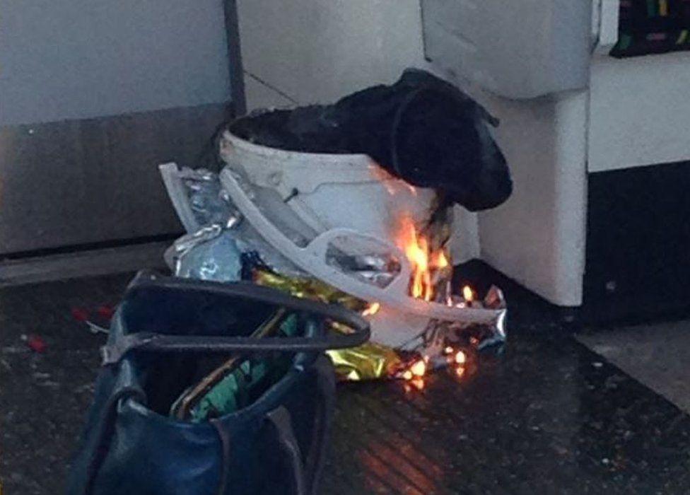 White bucket on fire on Tube train