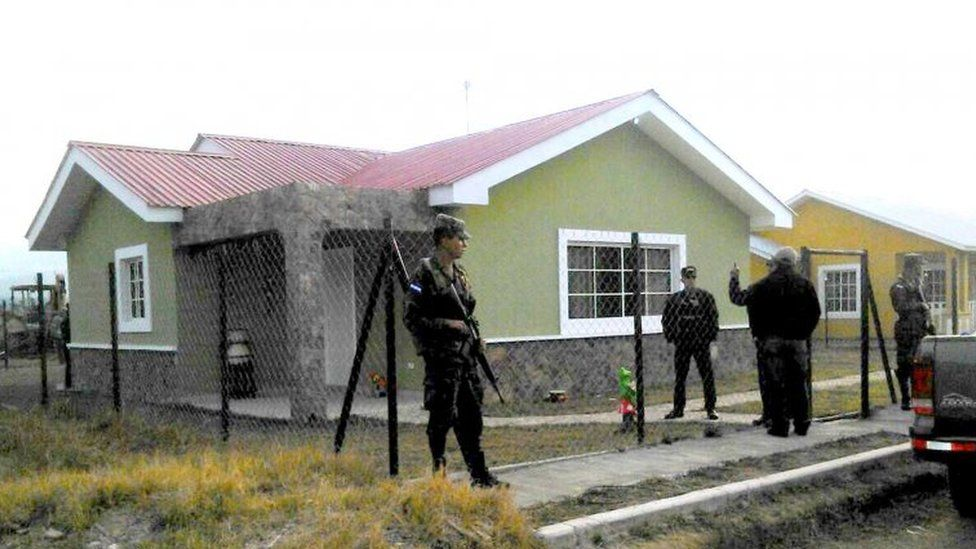 Soldiers watch the house where Honduran environmentalist Berta Caceres was murdered, in La Esperanza, 200 km northwest of Tegucigalpa, on March 3, 2016.