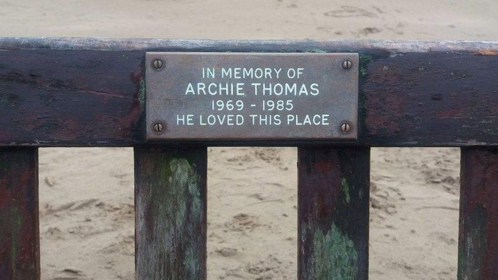The plaque on Archie Thomas' memorial bench
