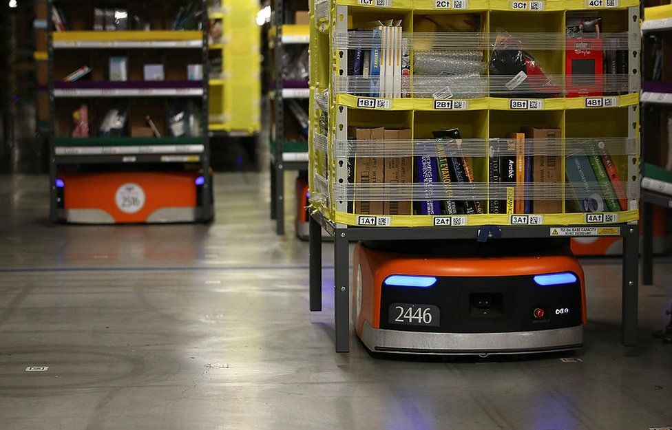 Kiva robots move racks of merchandise around an Amazon warehouse