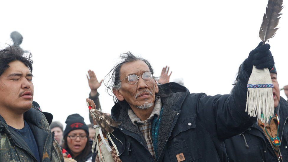Nathan Phillips prays with other protesters near the main opposition camp against the Dakota Access oil pipeline near Cannon Ball, North Dakota, U.S., February 22, 2017