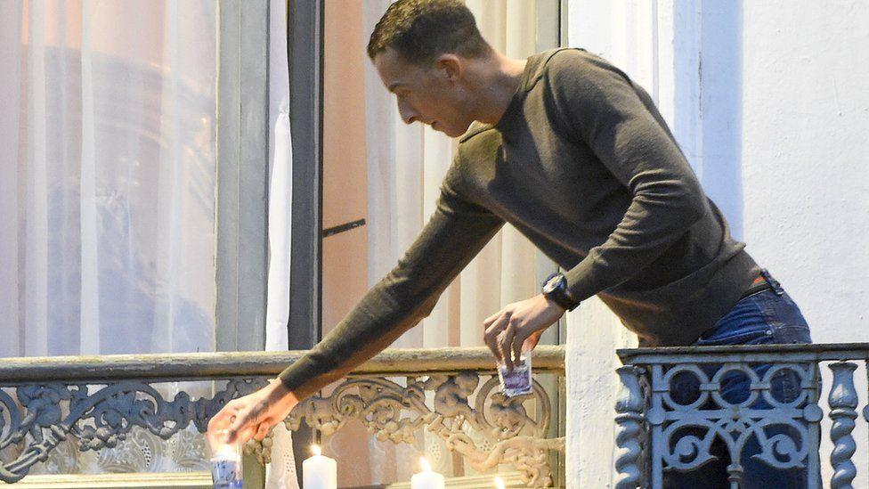 Mohamed Abdeslam, brother of Brahim Abdeslam, lights candles to remember the Paris victims (18 Nov)