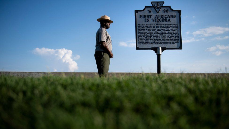 Sign marking point where African slaves were first brought to the US