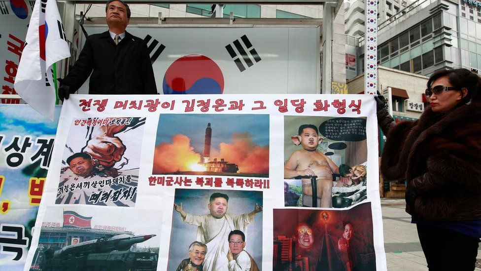 South Korean activists hold a banner depicting Kim Jong-un in various derogatory ways during a rally against North Korea's latest ballistic missiles test. Seoul, South Korea, 8 March 2017.