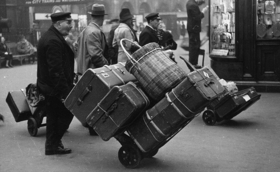 Person with suitcases