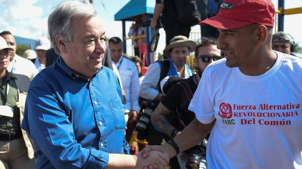 United Nations Secretary-General Antonio Guterres (L) shakes hands with a former member of the Revolutionary Armed Forces (Farc) in Colombia in the Mesetas municipality, Meta department, Colombia 14 January 2018