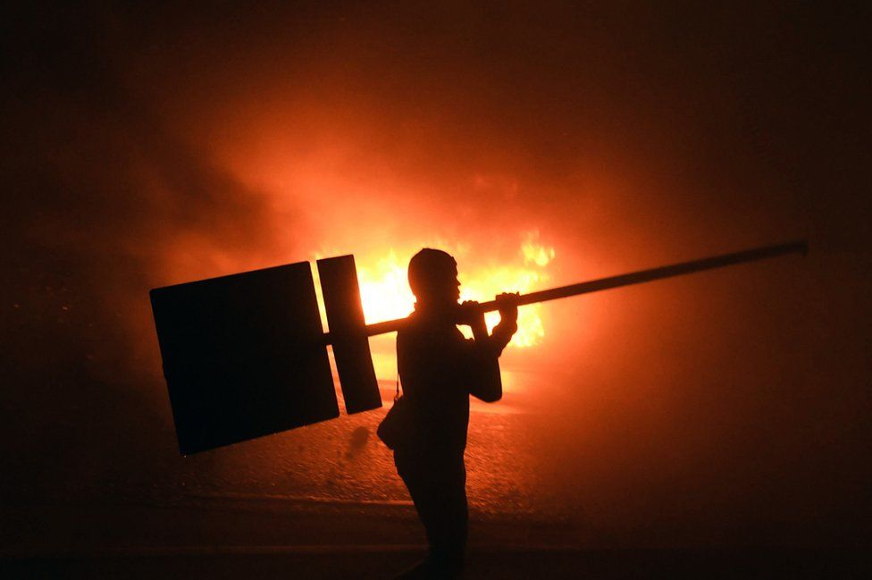 Supporters of Honduran presidential candidate for the Opposition Alliance against the Dictatorship party Salvador Nasralla, set a barricade alight during a protest outside the Electoral Supreme Court (TSE), to demand the announcement of the election final results in Tegucigalpa, on November 30, 2017.