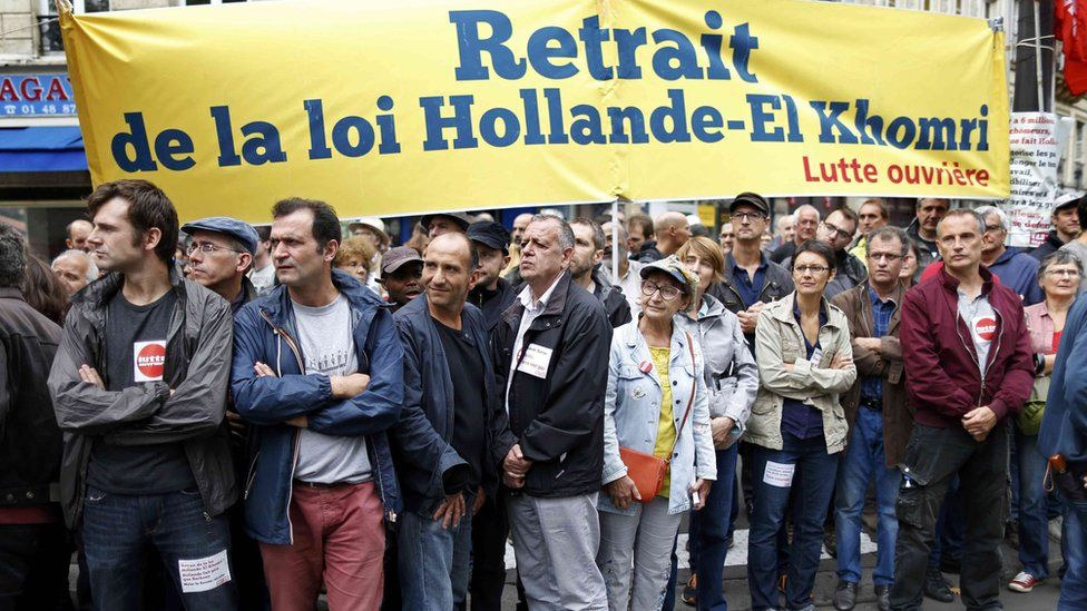 """Members of France""""s """"Lutte ouvriere """" take part in a protest"""