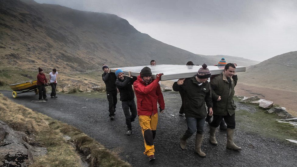 Carrying panel and boat up Miners' Track to Llyn Llydaw