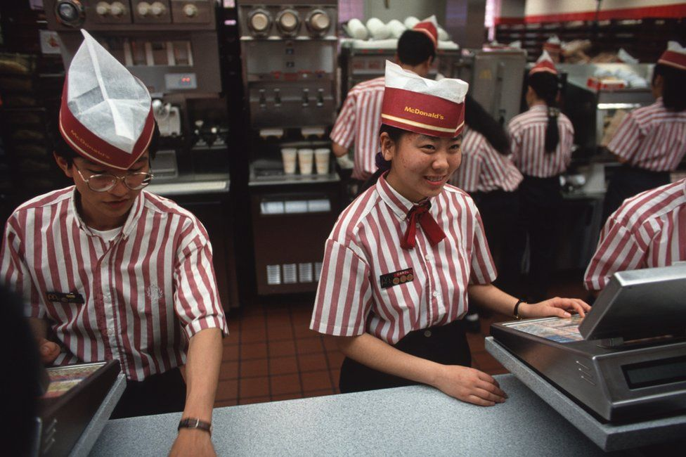 Staff at the first McDonald's restaurant in China, which opened in Shenzhen in 1990