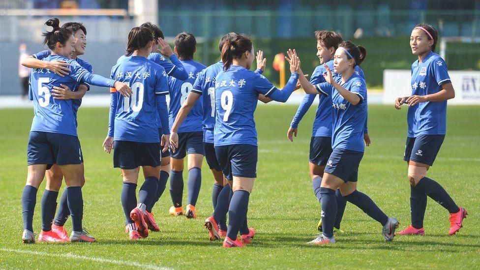 China Football Hair Colour Cancels Play At Women S Match Bbc News