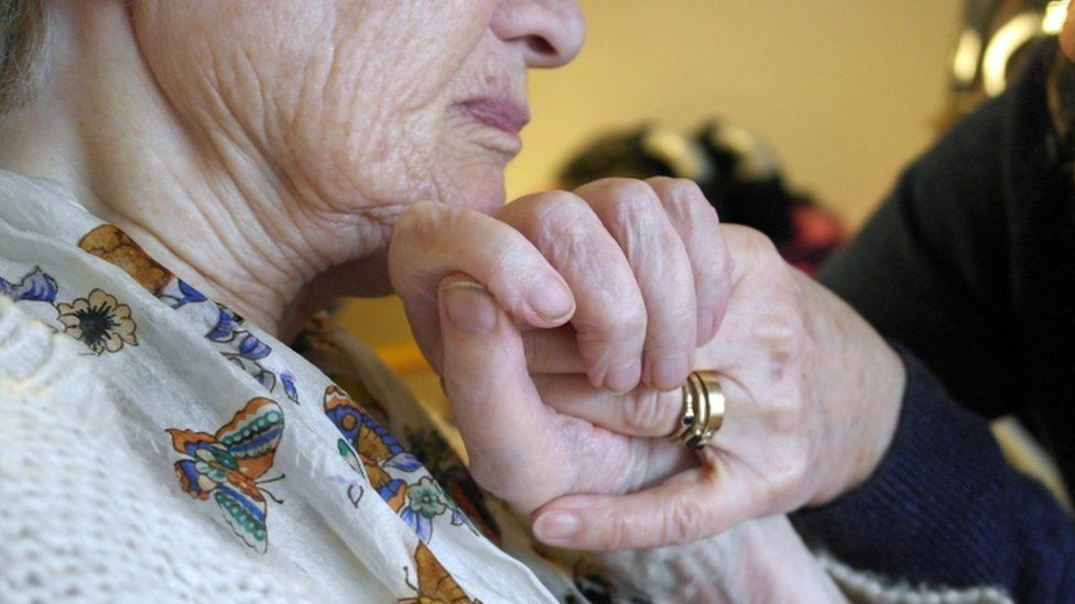 Elderly person being cared for at home