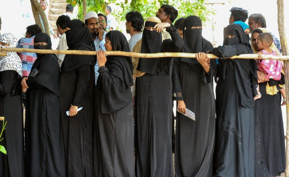 Indian Muslim women stand in a queue to cast their vote at a polling station in Kurnool district of the Indian state of Andhra Pradesh, on April 11, 2019.