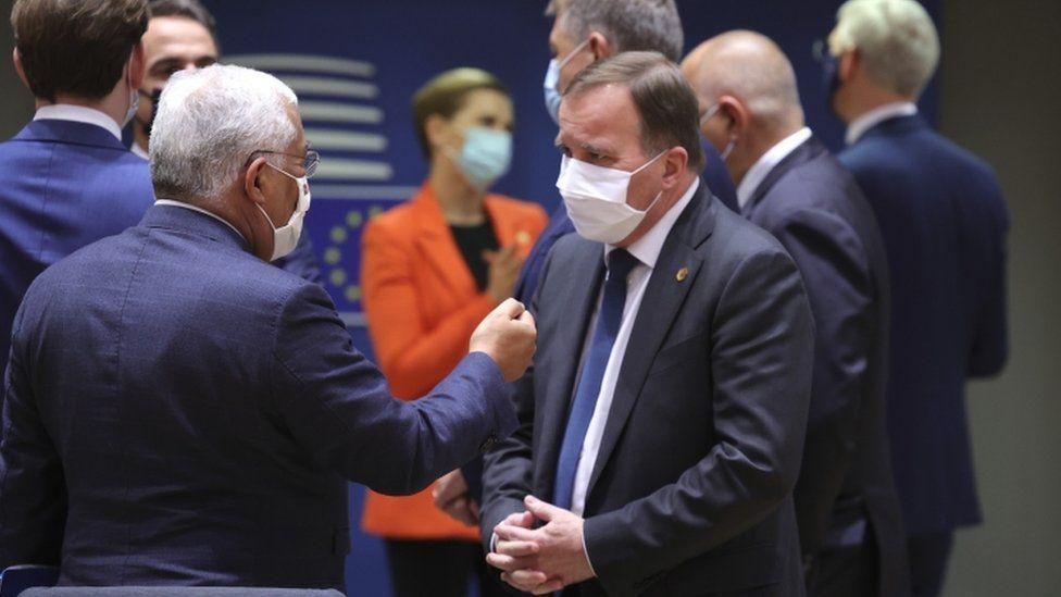 Portugal's Prime Minister Antonio Costa (L) speaks with Sweden's Prime Minister Stefan Lofven