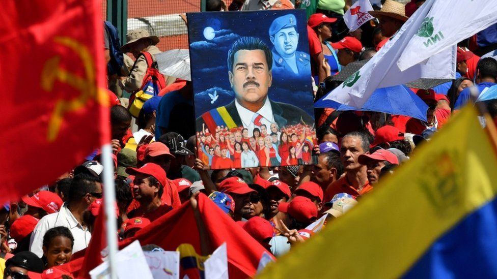 Supporters of Venezuelan President Nicolas Maduro gather to mark the 20th anniversary of the rise of power of the late Hugo Chavez, the leftist firebrand who installed a socialist government, in Caracas on February 2, 2019