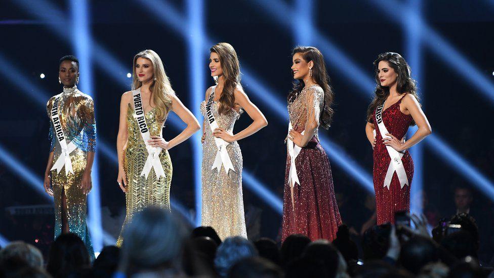 The top five Miss Universe contestants - including Zozibini Tunzi - on stage