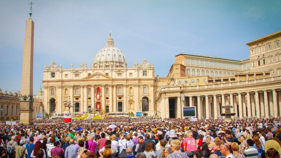 Crowds gather outside St. Peter's Basillica in Rome to hear the Pope speak on Easter Sunday 2011