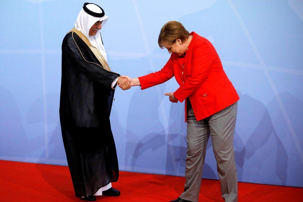 German Chancellor Angela Merkel welcomes Saudi Minister of State Ibrahim Abdulaziz Al-Assaf at the G20 summit in Hamburg, 7 July